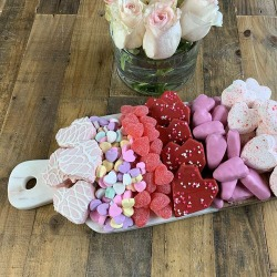 Pinterest image of Be My Valentine cakes and brownies on a Valentine's themed charcuterie board.