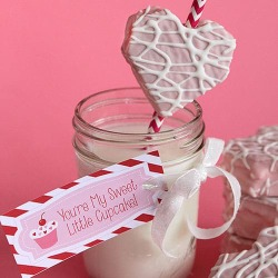 Pinterest image of Be My Valentine cakes on a paper straw with a glass of milk.