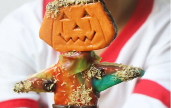 Scarecrow Pops are made of rice cereal treats, fruit leather, shredded wheat cereal, melted chocolate, and Little Debbie Brownie Pumpkins.